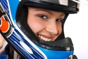a woman with a helmet smiling