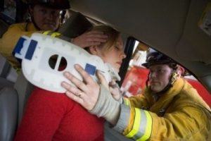 woman getting first aid after a car crash