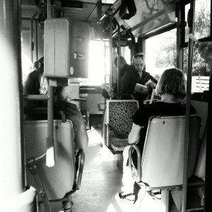black and white image of passengers in bus