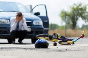 man at the scene of a bike car accident