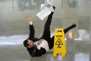 Man falling down on lobby ground, hotel injuries