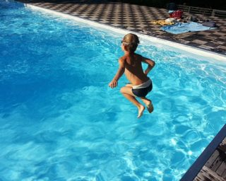 boy jumps into pool_best personal injury attorney in las vegas
