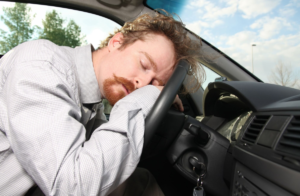 a senior man sleeping on steering wheel, auto accident