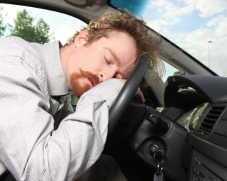 a senior man sleeping on steering wheel, auto accident
