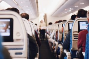 indoor view of an airplane with passengers, personal injury attorney