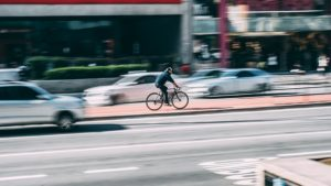 a cyclist riding on street, Las Vegas car accident attorneys