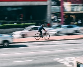 a cyclist riding on street, Las Vegas car accident attorneys