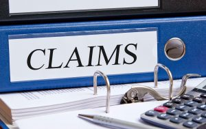 a claims folder on desk