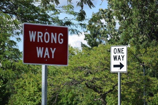 wrong way warning road sign