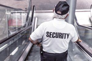 A security man taking elavator