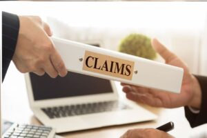 Passing a folder with claims label to another person