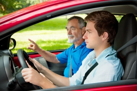 Teen driver and an instructor in passenger seat