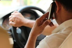 Backview of a man driving while talking to cellphone