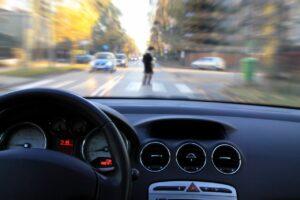 A fast-speeding driver sees a pedestrian crossing