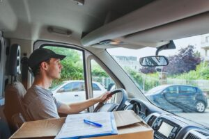 Delivery driver is driving